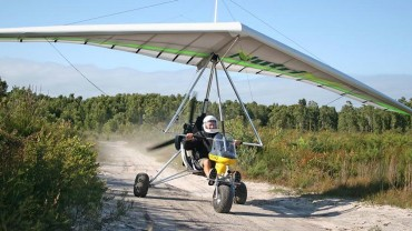 Ultralight trike landing on dirt road